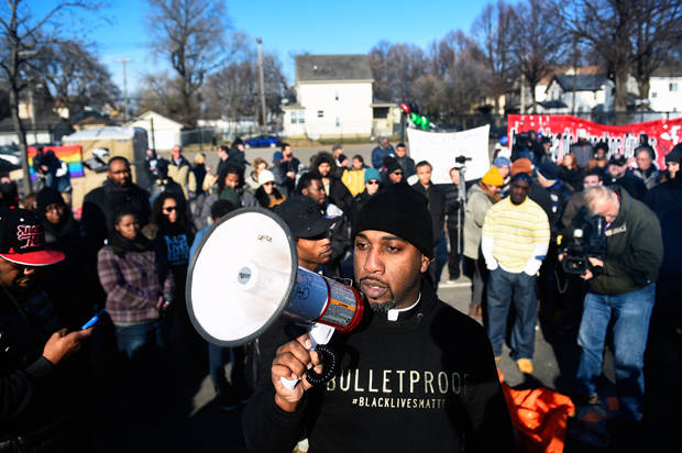 Danny Givens Jr. of St. Paul, Minnesota speaks to a gathering crowd of the group Black Lives Matter before they march to city hall during a protest in Minneapolis, Minnesota